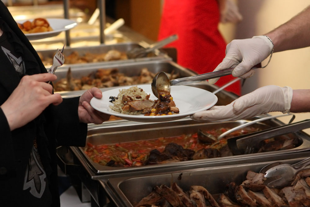 Caterer Serving Food To Guest - Catering in Washington D.C.